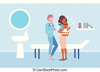 female doctor pediatrician giving injection vaccine shot to...