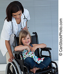Female doctor pushing a wheelchair