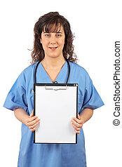 Female doctor showing a blank clipboard