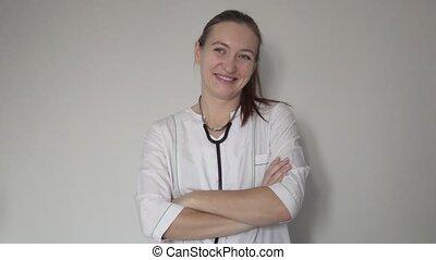 Female doctor smiling at camera at hospital
