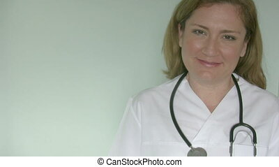 Female doctor smiling at camera.