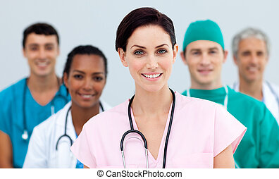 Female Doctor standing in Front of her team