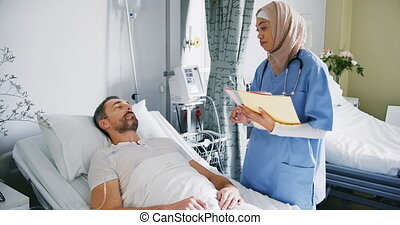 Female doctor talking with patient in hospital bed 4k