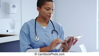 Female doctor using digital tablet in hospital 4k