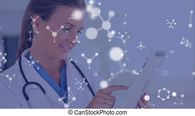 Female doctor using tablet computer with moving molecular structures