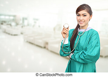 female doctor wearing a green scrubs and stethoscope in hospital