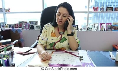 Female doctor with cellphone
