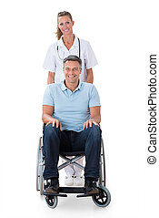 Female Doctor With Patient On Wheelchair