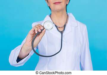 Female doctor with stethoscope, close up