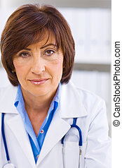 Female doctor working at office - Portrait of senior female...