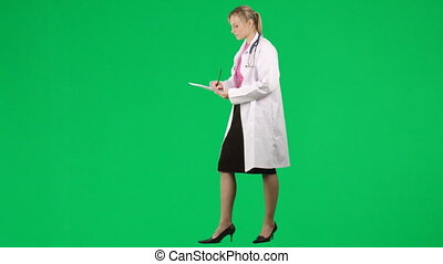 Female doctor writing a patient report