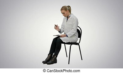 Female doctor writing recipe for a patient on white background.