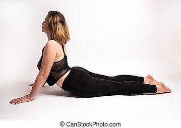 Female doing a cobra backbend yoga pose