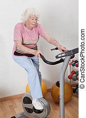 Female Doing Physical Exercise - Portrait of senior female...