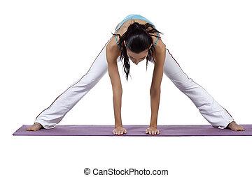 female doing yoga tic exercise