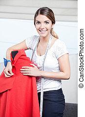 Female Dressmaker Adjusting Clothes