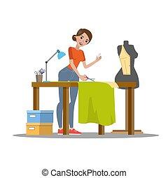 Female dressmaker cutting cloth
