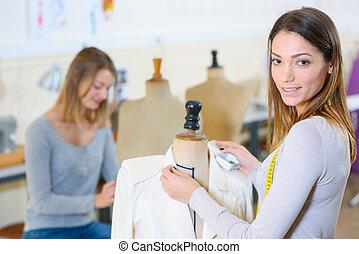 female dressmaker working in studio