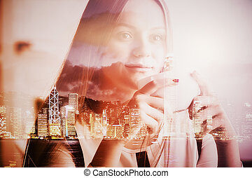 Close up portrait of thoughtful smiling caucasian female drinking coffee. Night city background