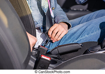 Female Driver Attaching Safety Seat Belt in a Car