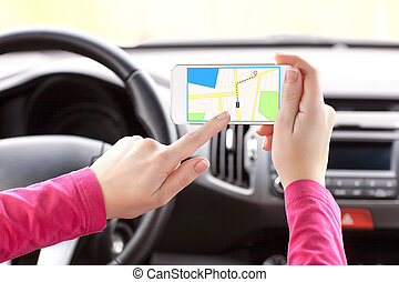 female driver hand holding a phone with interface navigator...