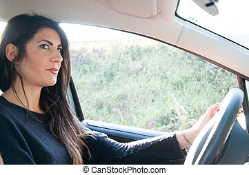 female driver that start a travel with his car