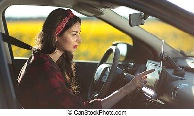 Female driver using gps navigation on trip pc