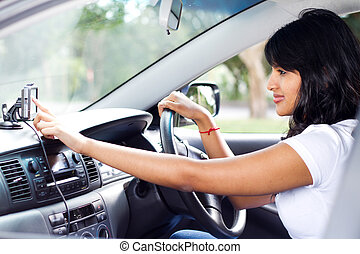 driver using GPS navigator - female driver using GPS...
