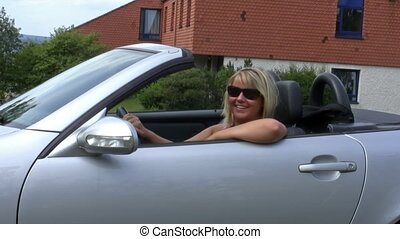 Female driver with sunglasses - Young woman in her ragtop