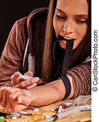 Female drug addict with syringe. - Female drug addict with ...