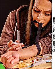 Female drug addict with syringe. - Female drug addict with...