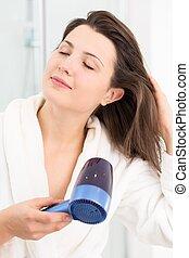 Female drying hair