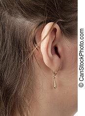 female ear with earring
