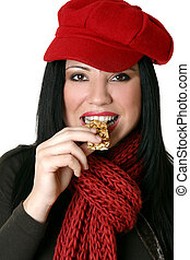 Female eating healthy nut bar - A female eating a healthy ...