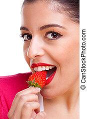 Female eating strawberry