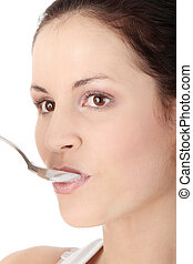 Female eating yoghurt