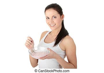 Female eating yogurt isolated on white background