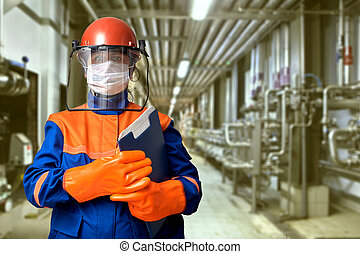 Female electrical engineer with protective gear. - A ...