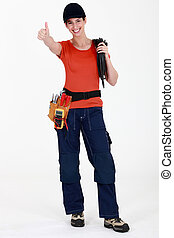 Female electrician giving thumbs-up