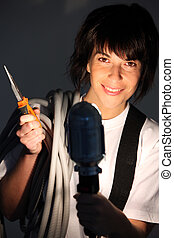 Female electrician holding pliers