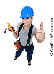 female electrician thumb up