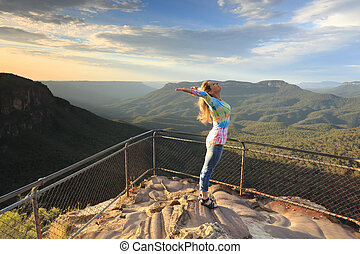 Female embrace the new day with positive affirmations Blue Mountains Australia