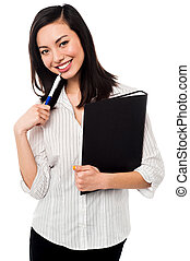 Female employee holding office files
