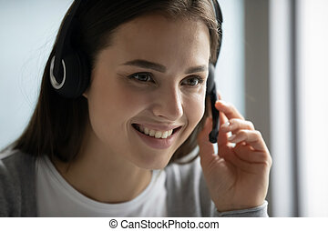 Female employee in headset consult client online