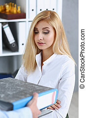 Female employee show pack of documents