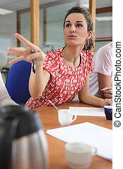 female employee speaking in meeting