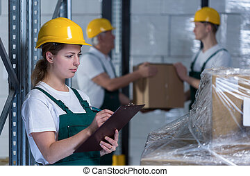 Female engineer controlling work in manufacturing plant