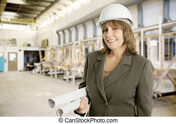 Female Engineer in Factory - Attractive female engineer with...
