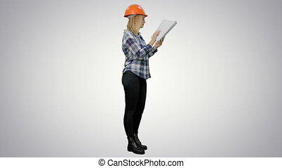 Female engineer inspects construction site and talking to workers to correct them on white background.