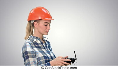 Female engineer operating a drone analyzing object on white...